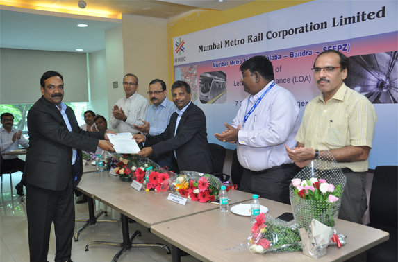 Contractor recieveing LOA from the hands of MR. S.K.Gupta, Director (Projects)