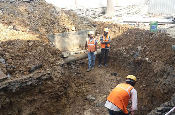 Storm water drain manual excavation in progress at Seepz Station