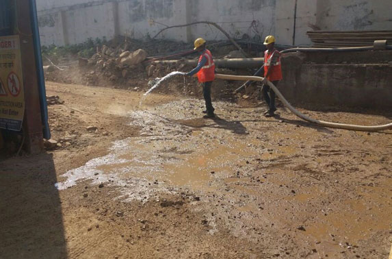 Water sprinkling for dust control in progress at Seepz Station
